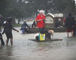 Aug. 28, 2017 – Houston, TX – People wait for a rescue boat as they flee their homes. (Joe Raedle / Getty)